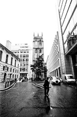London Street: J Walking (christait) Tags: road street uk man london crossing traffic britain suit cabs 2012 ilforddelta3200 leicam3 jwalking ilfotechc voigtlander21mmf4colorskopar