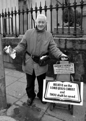 Spreading The Word (Owen J Fitzpatrick) Tags: saved street city ireland people dublin man male monochrome sign bag word lens photography spread belt message christ god pavement candid preacher religion jesus belief 7 joe save lord eire holy elderly believe be paving zipper dslr unposed tamron flyers marlborough railings cl hold bless placard blessed chasing verse spreading thou 2014 nahum goog preacherman leaflets nikond3200 superzoom republicofireland persuade shalt ojf knoweth nikond3100 owenjfitzpatrick ojfitzpatrick