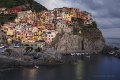 Cinque Terre Italy (john white photos) Tags: red sea italy orange house heritage yellow boats lights coast fishing italian europe dusk painted cliffs coastal cinqueterre manarola villiage