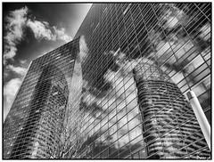 Reflets et nuages - Reflections and clouds (baladeson) Tags: bw paris france monochrome architecture clouds reflections noiretblanc ciel nuages reflets ladfense