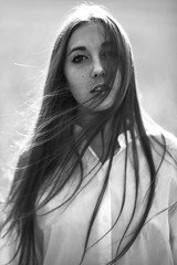 A warm spring breeze (Kenny Laurence) Tags: portrait blackandwhite sunlight nature girl backlight hair model nikon natural wind 85mm freckles hairflip samyang