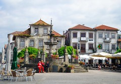 town square (ekelly80) Tags: portugal caminha june2016 summer minho vianadocastelo town square fountains building architecture cafes flowers umbrellas