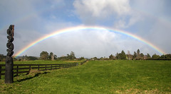 Rainbow over battle site (Kiwi-Steve) Tags: nz newzealand northisland bayofplenty tauranga pyespa gatepa teranga battlesite rainbow field nikon nikond90 maoriwoodcarving maori fence landscape