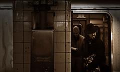 Man with hat in the subway (Harry Szpilmann) Tags: nyc people portrait manhattan urban subway newyork streetphotography usa monochrome