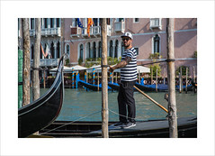 The modern Gondolier (andyrousephotography) Tags: venice gondolier gondola gondoliersguild 1000years closedshop profession 425 licenses giorgiaboscolo uniform sailorsshirt striped red navy modern twist baseballcap nike trainers smartphone earphones andyrouse canon eos 5d mkiii