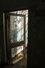 Step into the light (Pompey Photo Bunny) Tags: door light urban abandoned broken dark island peeling paint exploring neglected shade strong portal derelict deserted isolated decayed urbex strongisland