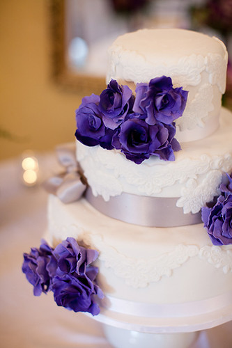 """A purple and white applique wedding cake. • <a style=""""font-size:0.8em;"""" href=""""http://www.flickr.com/photos/50891271@N03/15725507144/"""" target=""""_blank"""">View on Flickr</a>"""