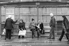 Street Life (Capt'n Red Beard) Tags: life street people blackandwhite bw bus monochrome liverpool mono candid sony group olympus stop queue zuiko f4 a7 200mm