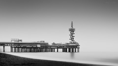A Moment In Time (barryvanede) Tags: longexposure winter sea sky bw white snow seascape black reflection beach water monochrome mono pier blackwhite movement nikon long exposure moody 10 scheveningen smooth nederland ede minimal stop le lee barry nd van minimalism filters 13 minimalistic minimalist stops d90 nd110