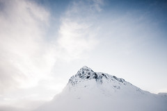 Buachaille Etive Mor. (katemortoncp) Tags: winter snow mountains clouds landscape scotland scenery ominous scottish bluesky rockface hills remote icy atmospheric isolated rugged munro buachailleetivemor mountainpeak mutedtones