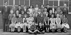 Class photo (theirhistory) Tags: girls england boys socks children shoes dress sandals teacher jacket junior shorts schoolphoto wellies primary