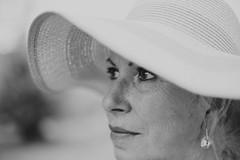 Un petit air de Catherine Deneuve... (Amlie Roy) Tags: portrait bw woman sun white monochrome beautiful look hat lady spring eyes dof bokeh deep bokehlicious makeportraits
