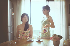 It's all about finding the calm in the chaos. -Donna Karan (Yuri Figuenick) Tags: girls two portrait woman selfportrait girl fashion fairytale myself table asian japanese twins women funny quiet dress tea pastel magic portraiture backlit pour teatime selfie canoneos5dmarkiii