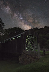 A Listless Repose (reflectioninapool) Tags: appalachia westvirginia architecture astrophotography bridge color coveredbridge forest glow light longexposure milkyway night old outdoors rectangle scenic sky stars structure trees vertical wooden renick unitedstates us