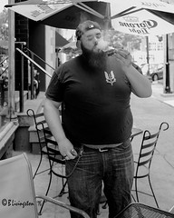 The Puffer (Bruce Livingston) Tags: bw monochrome umbrella streetphotography cigar mothers smoker acrossimulation