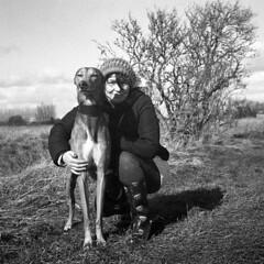 Anita and the Lurcher (Trojan_Llama) Tags: portrait blackandwhite bw dog english 120 film mediumformat countryside creative agfa agfaisolette fenland lurcher foma walkingthedog isolette foldingcamera homedeveloped fomapan scannedfilm i