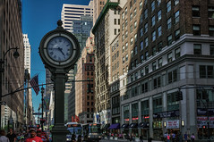 Time (Мaistora) Tags: street city nyc blue windows sky people urban usa ny newyork color colour building clock skyline architecture zeiss america skyscraper buildings reflections shopping walking t relax us warm day afternoon traffic unitedstates faces time walk manhattan flag sony crowd banner sunny patriotic tourist tourists international busy timepiece shops 24mm colourful process avenue teatime 5th postprocess multitude edit crowded topaz 44th lightroom starsstripes sonnar coffeetime nex slowdown west44thstreet diersity maistora 5r oloneo yahoo:yourpictures=weather sel24f18za nex5r