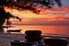 Red Sunrise (Yudho Wiratomo) Tags: beach sunrise indonesia balikpapan manggar