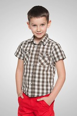 Cute young boy on the white background (khanov2007) Tags: boy red portrait people white cute smile childhood fashion cutout studio fun happy person stand kid european alone child little joy young handsome happiness indoor front glad single positive cheerful enjoyment pleasure isolated confident caucasian positivity