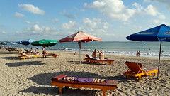Sunshine Beach (stardex) Tags: bali indonesia kutabeach kuta sand sky cloud sea umbrella sunlight