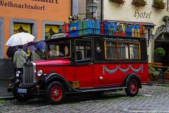 Cargado de sueos (raperol) Tags: street travel viaje germany calle lluvia rojo 300d viajes alemania rothenburg 2007 airelibre
