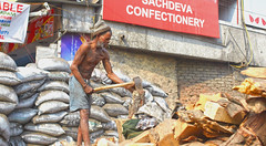 Chopping Wood (sparksy2k14) Tags: wood india canon delhi axe 5d