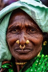 Adivasi woman, Bastar, Chhattisgarh (Simon Spicknell) Tags: portrait gold nikon streetphotography photojournalism tribal jewellery nosering tribe indigenous reportage nosestud documentaryphotography adivasi travelphotgraphy