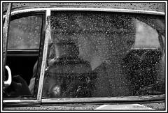 un sorriso dietro la pioggia (maurobrock) Tags: auto bw donna sorriso pioggia biancoenero automobilismo maurobrock millemigliabrescia
