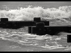 Role with the Tides (SaltyDogPhoto) Tags: ocean wood blackandwhite beach water monochrome photography coast newjersey nikon waves jetty shoreline nj coastal shore nautical oceancity crashing photooftheday saltlife nikonp100 saltydogphoto