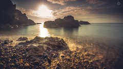 Shimmering Waters (Augmented Reality Images (Getty Contributor)) Tags: longexposure light sunset sun water clouds canon landscape scotland rocks waves tide morayshire portknockie leefilters