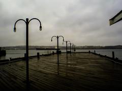 (daviddutrisac) Tags: ocean wet water lamp rain closeup clouds outdoors pier dock post