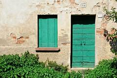 untitled (montagnana - padova, italy) (bloodybee) Tags: 365project montagnana padova padua italy europe street door window house facade urban building shadow shutter green wall number 14 50