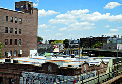 Elevated view from Brighton Beach Station (Robert S. Photography) Tags: subway elevated aboveground clouds ads billboard train b brooklyn brightonbeach nyc nikon color coolpix l340 iso80 summer june 2016