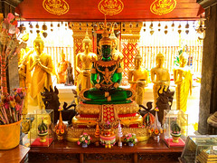 Statues In Buddhist Temple (Evgeny Ermakov) Tags: travel decorations red vacation sculpture sunlight green monument beautiful beauty statue thailand religious temple gold golden ancient asia southeastasia antique buddha interior buddhist traditional religion decoration culture sunny buddhism holy mai bust exotic destination chiangmai southeast typical wat chiang emerald th cultural phra buddhistic changwatchiangmai