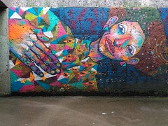 Street-Art Munich - Graffiti wall (reinh_3008) Tags: blue streetart texture face wall germany munich mnchen person graffiti hand smartphone colourful bunt sprayer liegend