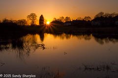 Cheshire Sunset (Sandy Sharples) Tags: uk blue sunset england orange sun reflection tree nature silhouette canon march spring pond cheshire