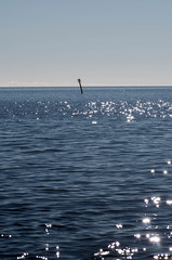 glitterlake (Mange J) Tags: blue sea sky lake water glitter pentax sweden clear sverige vrmland seamark tamronspaf90mmf28 lakevnern vrmlandsln magnusjakobsson k5ii