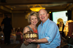 Jill & Steve Ronen displaying a live dessert auction cake (Lydia's Style Magazine) Tags: familyphotographer sportsphotographer seniorportraitphotographer fortcollinsphotographer northerncoloradophotographer photosbyadell