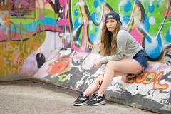 Sophie (ecker) Tags: portrait woman wall zeiss linz graffiti outdoor availablelight wand sony sophie 85mm naturallight portrt skatepark portraiture frau a7 kappe sitzen sonnar batis urfahr umgebungslicht zeissbatis1885