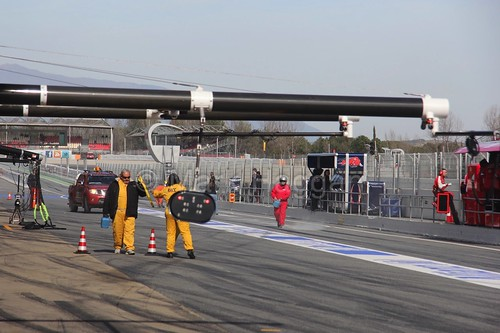 A yellow flag in the pit lane