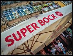 Super Bock (Guillermo R.) Tags: viaje costa portugal horizontal skyline ruta ro digital puente europa raw cerveza cara dia agosto ojos alcohol cabez