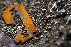 Edge (Amarand Agasi) Tags: road orange color macro broken closeup saturated colorful pavement stones rusty utata gravel razorblade razor rakishlight