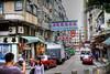 Snap shot (Filiola) Tags: china hongkong couple asia taxi snapshot overcast tourists april kowloon oldbuilding humid 2015