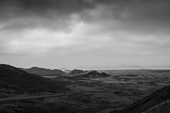 DSC07689 (Gumundur Rbert) Tags: sky white mountain black 35mm cycling climb iceland cloudy f14 sony climbing rolf prima reykjavk sland ares a7ii pansonic samyang reihjl rokinon