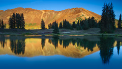 Golden Paradise Basin (jeanineleech) Tags: morning trees light mountain lake mountains reflection green water sunrise reflections landscape outdoors gold pond colorado glow outdoor peaceful bluesky goldenhour crestedbutte paradisebasin