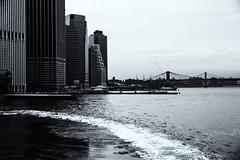 Wake (PAJ880) Tags: new york nyc bridge bw ferry brooklyn island wake manhattan lower staten