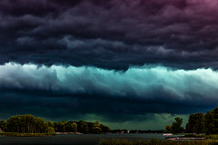 Storm Over Cedar Lake (John D. Stocker) Tags: new blue summer sky lake storm color green weather minnesota st clouds danger rural photography boat purple prague cloudy country patrick cedar thunderstorm mn severe johnstocker wwwpaintedspurphotographycom paintedspur stormcloudsweatherthunderstormskycloudy