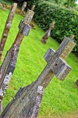 old graves (journo_bouy) Tags: grave graveyard gravestone cross church churchyard vibrant green grass leaning angles colourful