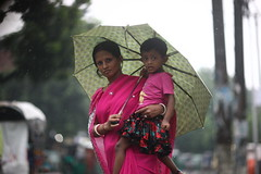 Monsoon Mom (N A Y E E M) Tags: mother child umbrella rain monsoon candid portrait afternoon street norahmedroad chittagong bangladesh sooc raw unedited untouched unposed carwindow colors