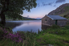 The Lady of the Lake (Leigh Cousins RAW) Tags: llynogwen lake wales snowdonia nationalpark ogwencottage water dusk boathouse flora tryfan mountain bluehour carneddauandglyderau civiltwilight dramatic scenery vibrant theladyofthelake excalibur